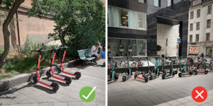 A group of electronic scooters parked properly, another group parked carelessly on the street.